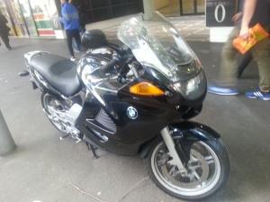 A motorbike on the sidewalk